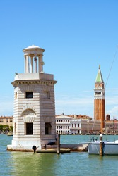 photo with lighthouse, saint marks campanile and grand canal in Venice, Italy.
