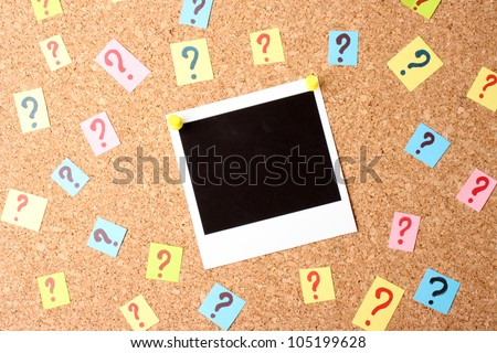 Photo with question marks cork board