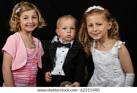 photo young family formal portrait on black
