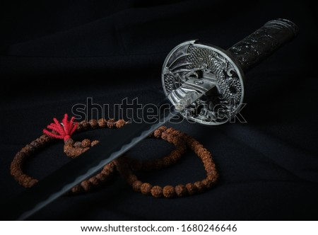 Photocomposition for background. Katana handle and rosary. Katana is a replica.