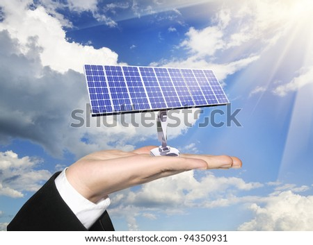 photoelectric cells of a solar panel on human palm