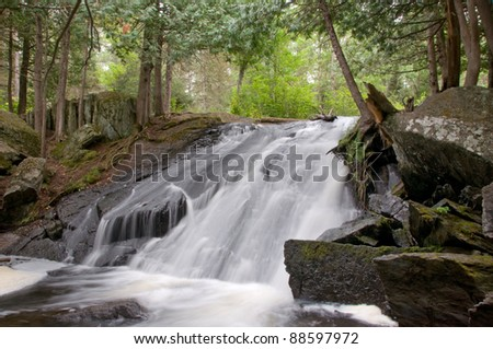 Photograph of a beautiful waterfalls in the Upper Peninsula of Michigan in the late summer, early Autumn period.