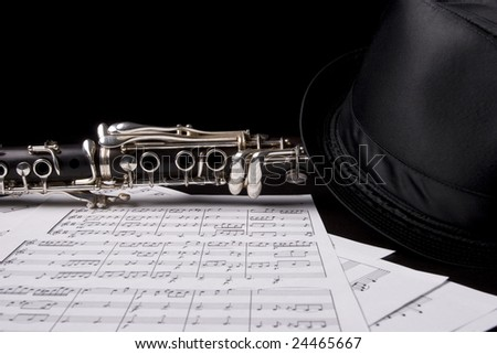 Photograph of a clarinet isolated over sheet music