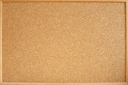 Photograph of a cork panel in a wooden frame ideal for backgrounds and textures. Panel for notes and photos of all kinds.