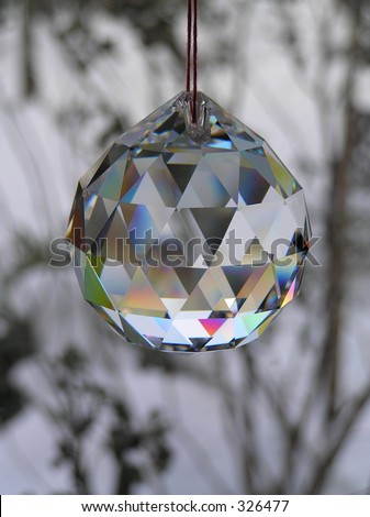 photograph of a crystal ball in front of a window