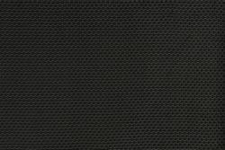 Photograph of a dark guitar amplifier texture