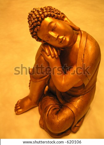 photograph of a golden buddha statue in a rare pose