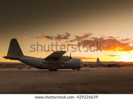 Photograph of a Hercules aircraft on land,ready to take off