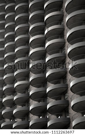 Photograph of a repetitive balcony detail in black and white #1112263697