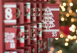 Photograph of a Wooden Advent calendar with the focus on door 25