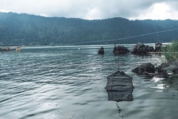 Photograph of old fish traps for fish standing in the water
