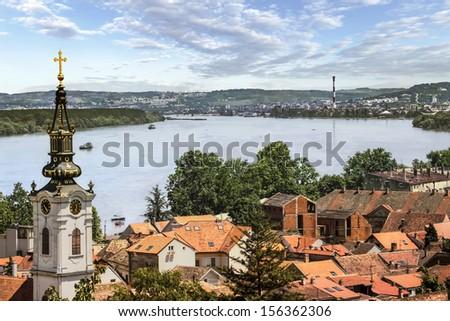 Photograph of panoramic view from Gardos - Zemun, with Saint Nicholas church baroque bell tower and river Danube. Zemun, Belgrade, Republic of Serbia.