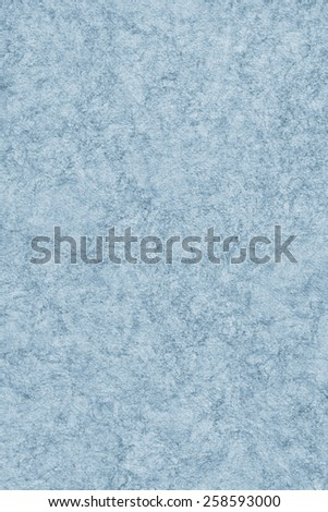 Photograph of Recycle Watercolor Paper, coarse grain, light Powder Blue, bleached, interspersed with delicate irregular linear pattern, grunge texture.
