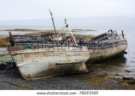 Photograph of rotting old boats taken near Salen on the Isle of Mull, Scotland on a typically overcast day.