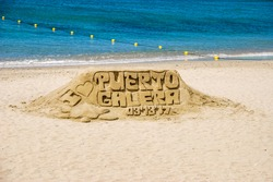 Photograph of sculpture made of sand, taken at White beach of Puerto Galera in province of Oriental Mindoro, Philippines . Sculptures of mermaids made of sand by the sea.