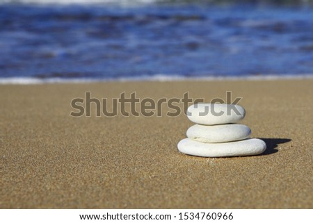 photograph of stones mounted on each other in perfect balance,
