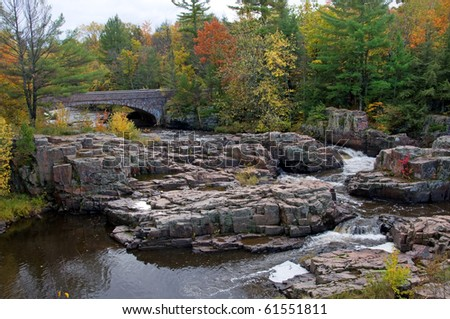 Photograph of the Dells of the Eau Claire, a spectacular series of small waterfalls between the rocks of a natural rock garden located in northern Wisconsin.  Shot during the beauty of autumn.