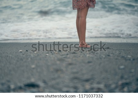 Photograph of the legs of a girl walking on the beach. Granada, Spain  #1171037332