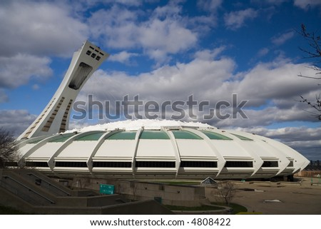 Photograph of the Montreal Olympic Stadium at daylight.  Check out images from the same angle taken at nigh or during a storm.