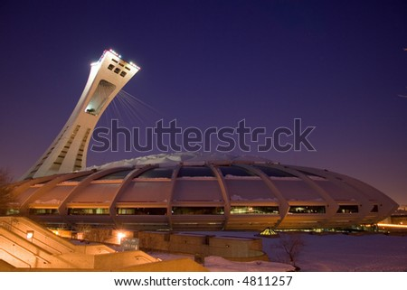Photograph of the Montreal Olympic Stadium under a gorgeous violet sky. Check out images from the same angle taken during a storm or during a sunny day.