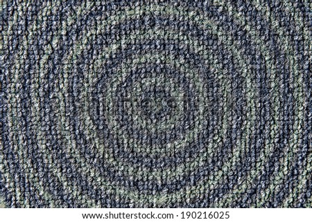 photograph shows a small shaggy rug in blue - green circles