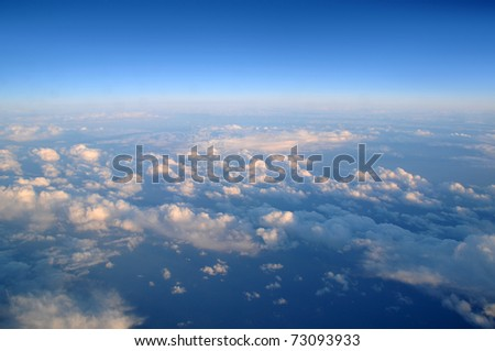 Photograph taken above the clouds over the Pacific Ocean.