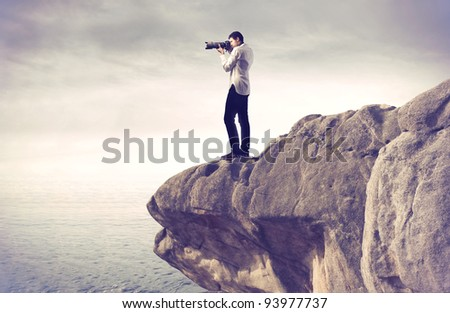 Photograph taking pictures from a rock over the sea
