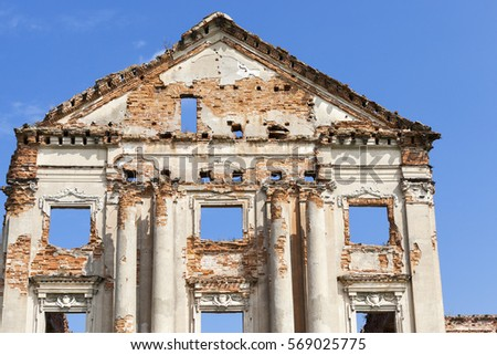 photographed close-up of the remaining ruins of the ancient castle in the village of arches Ruzhany territory of the Republic of Belarus. palace was built of red brick in the 17th century. stock photo