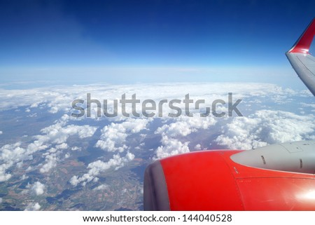 Photographed clouds from a plane / plane and clouds