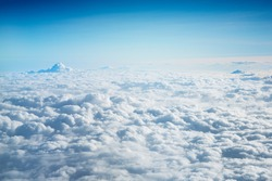photographed from an airplane flying above the clouds