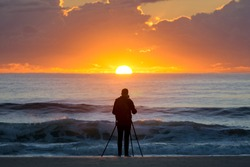 Photographer at sun rise
