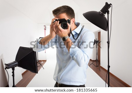 Photographer at work in his photographic studio