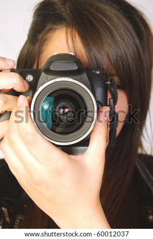 Photographer during a photo shoot,  in a photographer studio
