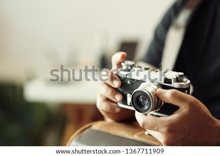 Photographer hands holding vintage camera
