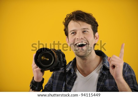 photographer has an idea or inspiration on yellow background - stock photo