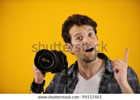 photographer has an idea or inspiration on yellow background