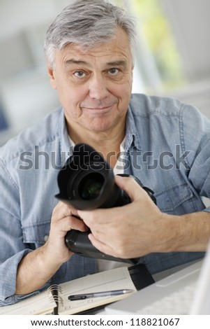 Photographer holding professional camera