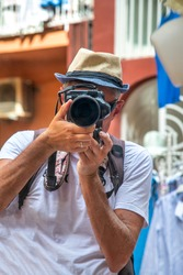 Photographer in Amalfi taking pictures of beautiful town, Italy