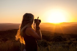photographer in the sunset, woman's silhouette