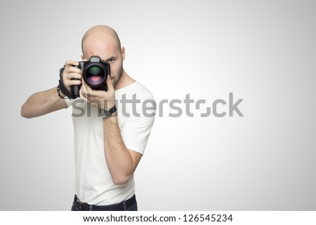 Photographer in white studio
