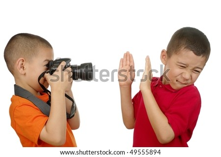 photographer kid taking unwanted paparazzi-style photo, isolated on white background