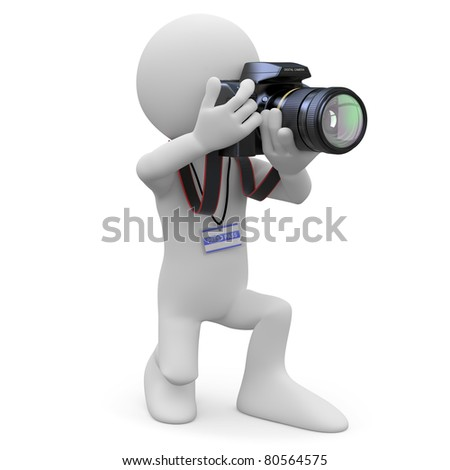 Photographer kneeling with his SLR camera