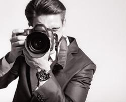 Photographer man is using professional camera