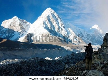 photographer on mountains - hiking in Nepal - way to everest base camp