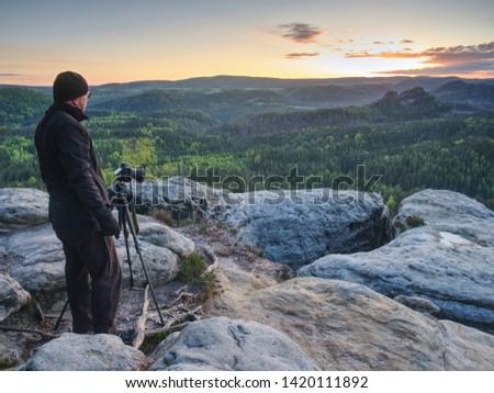 Photographer or videographer traveler thinking and set  tripod for digital camera. Artist prepared for an art work.  #1420111892