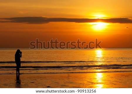 Photographer over the sunset