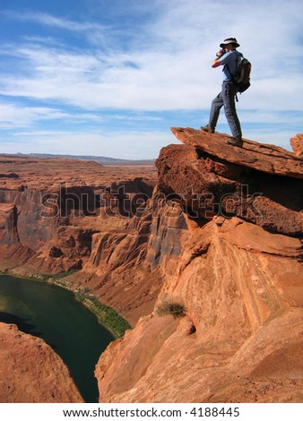 Photographer overlooking Grand Canyon