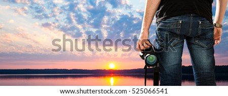 photographer photographic camera dslr photo person passion outdoor photographing travel make photography sunset sky background space banner concept - stock image