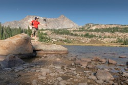 Photographer recording with an action camera at Lion Lake in Rocky Mountain National Park, Colorado, USA.