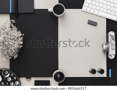 Photographer's desk with vintage camera, coffee and keyboard. Modern Grey and black table. Flat lay with copy space.